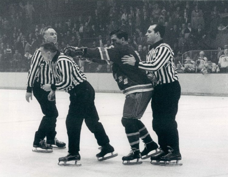 Bernie Geoffrion cross-checking linesman Walter Atanas February 8 , 1967