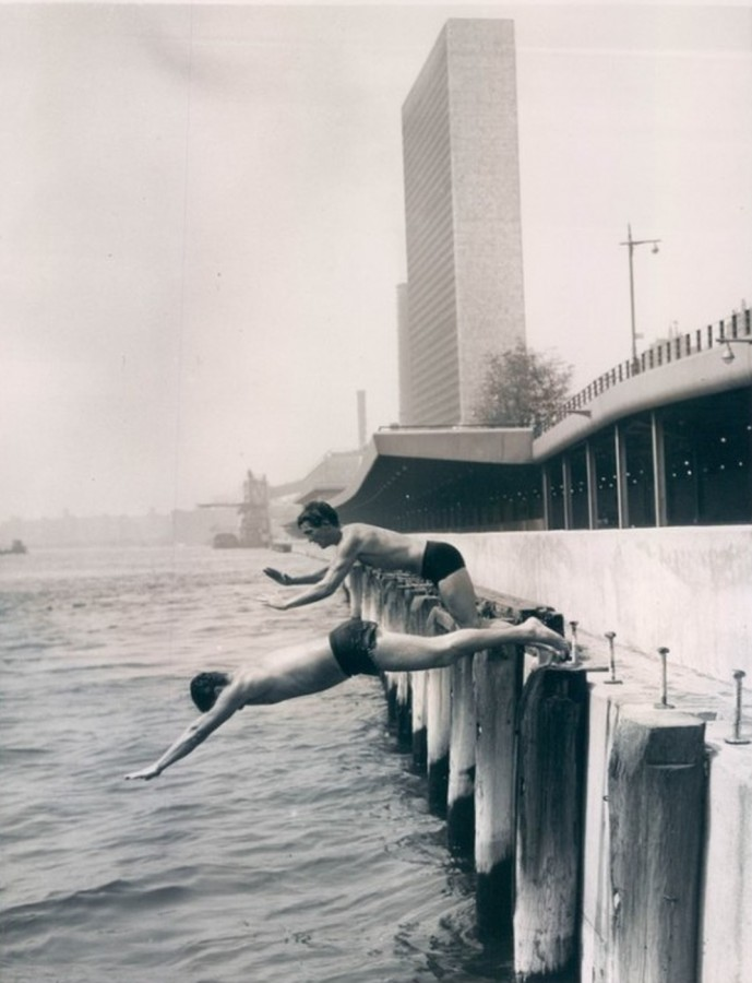 Joe Funranolla and Ray Bardini beat the heat by diving into the river July 22 1955
