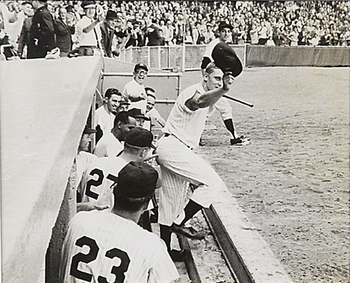 Roger Maris emerges from the dugout to tip his cap after hitting his 61st home run of the season. October 1, 1961