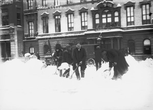 Men shoveling snow in front of Everett House 17th Street north side of Union Square January 25, 1908