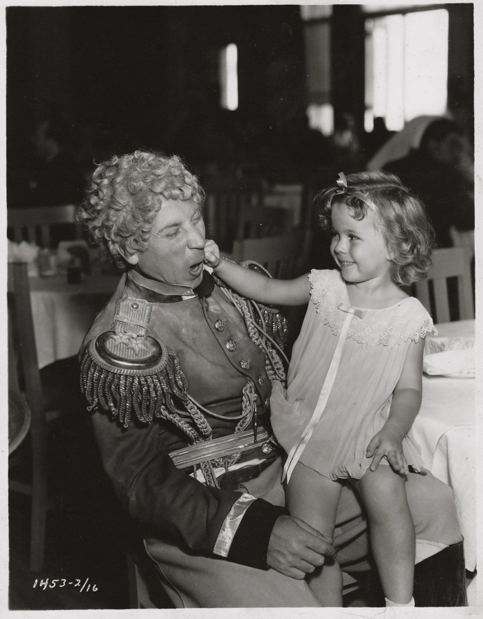 Harpo Marx with Shirley Temple in the studio commissary during the filming of Duck Soup 1933
