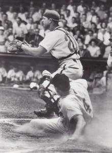 Ralph Kiner slides safely past Phillies catcher Andy Seminick at Shibe Park May 7, 1949