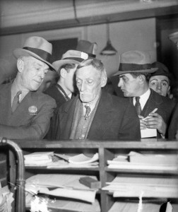 Child killer and cannibal Albert Fish is led into homicide court by detective William King, who captured Fish after a six year search. photo Acme