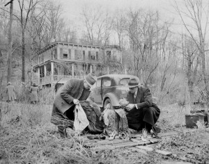 Albert Fish Crime Scene 1934 - Investigators check over a doll's wig, women's shoes and a man's suit , found near the deserted Westchester home where Albert Fish murdered Grace Budd. photo: Daily News