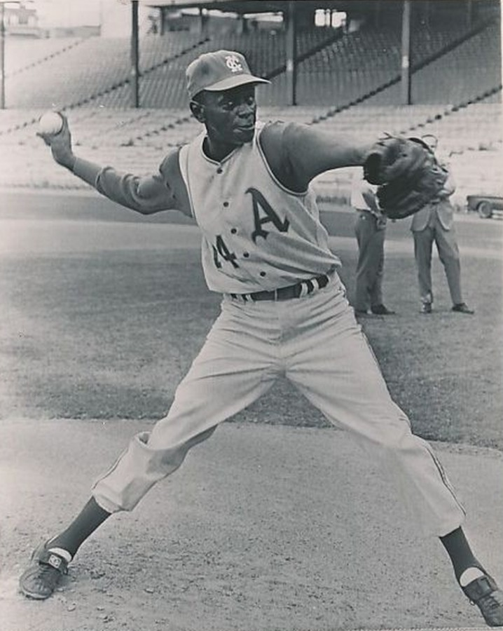 Satchel Paige, age 59 warming up on September 13, 1965  two weeks before facing the Red Sox photo: AP