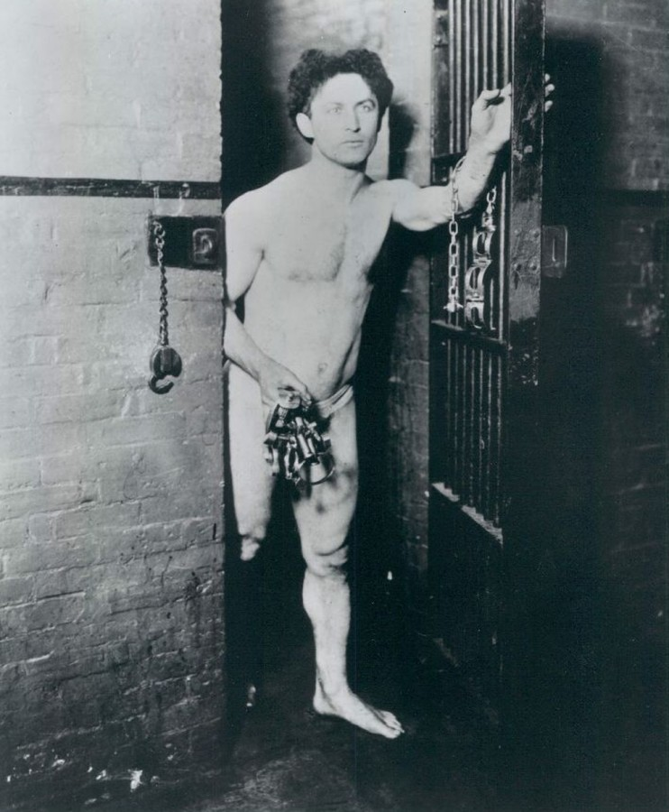 Houdini Emerges from jail cell