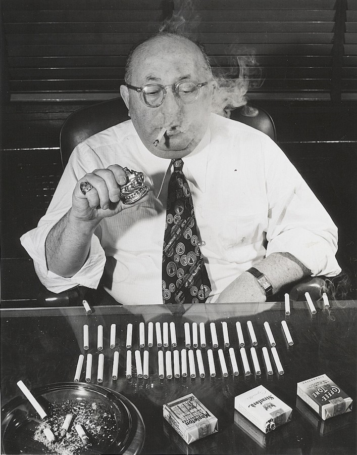 Man tests cigarettes for a living photo Acme 1945