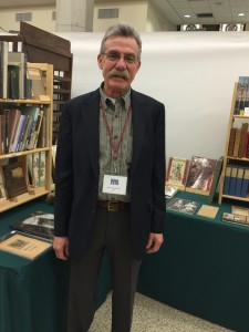The ever affable John Liberati of John Liberati Books stands in front of his booth
