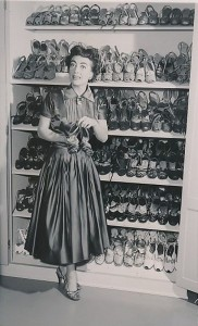 Joan Crawford shows off one her 500 pairs of shoes 1954 6 23