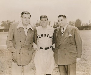 Babe Ruth, William Bendix and a studio executive on the set of The Babe Ruth Story