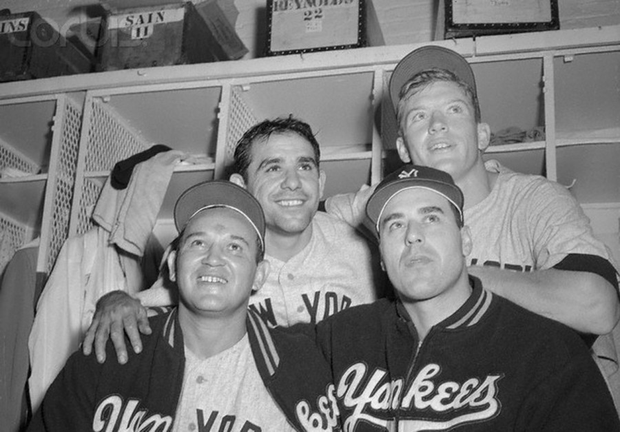 clockwise - Yogi Berra (without cap), Mickey Mantle, Vic Raschi and Allie Reynolds celebrate 3-2 World Series game 6 victory over Brooklyn Dodgers at Ebbets Field - October 6, 1952