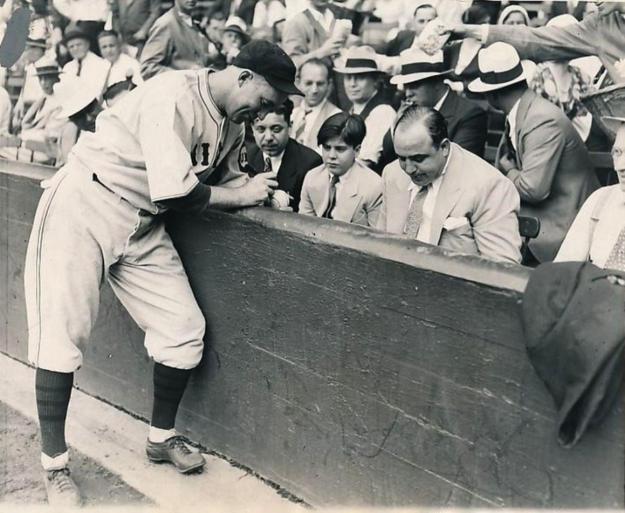 Al Capone sees a Cubs game with son as Gabby Hartnett signs autograph 1931 9 10