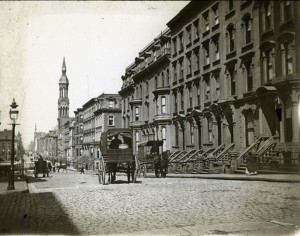 New York City street scene showing brownstones and church affluent neighborhood circa 1885
