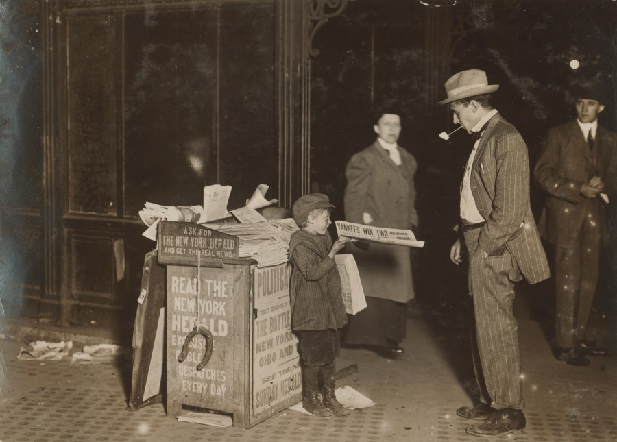 Jerald Schaitberger of 416 W. 57th St. N.Y. helps his older brother sell papers until 10 P.M. on Columbus Circle. 7 yrs. old. 9:30 P.M., October 8, 1910. Photo by Paul B. Schumm / Library of Congress