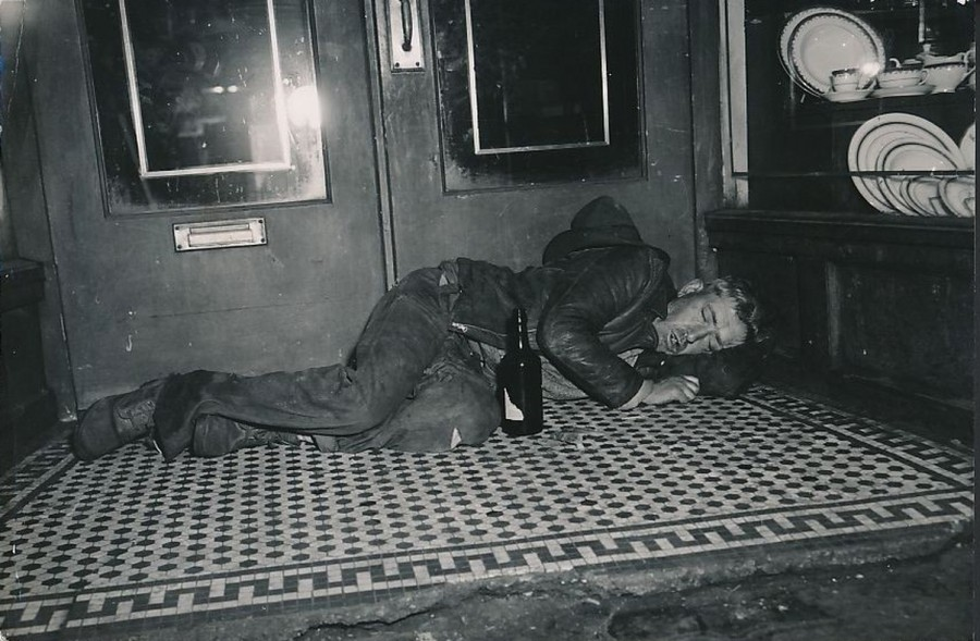 Bowery bum sleeps it off, 1949. photo: Howard Byrne