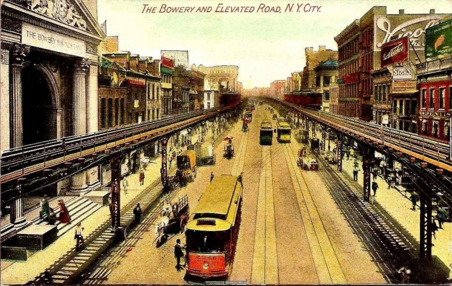 The Third Avenue Elevated at the Bowery. The Bowery Savings Bank Building is on the left.