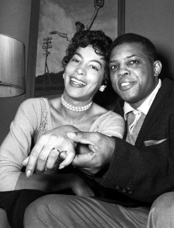 Feb 14, 1956 --- New York Giants star outfielder Willie Mays, 25, is shown with his bride of a few hours, Marguerite, (Wendelle), 27, at her home in Elmhurst, New York, after their wedding in Elkton, Maryland, early on February 14th. It is Willie's first and her third marriage. En route to Elkton, Mays was arrested for driving 70 miles an hour on the New Jersey turnpike and paid a $15 fine. photo - Associated Press