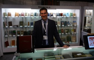 Dan Whitmore of Whitmore Rare Books in his booth