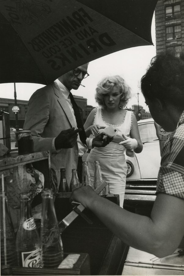 Marilyn Monroe and Arthur Miller with hot dog vendor at the Battery photograph: Sam Shaw