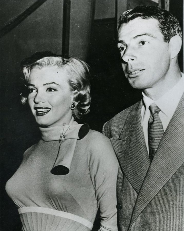 Marilyn Monroe and Joe DiMaggio. Note the giant safety pins holding Marilyn's scarf in place.