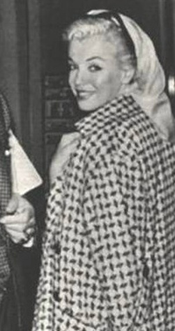 Marilyn Monroe caught in a candid moment.