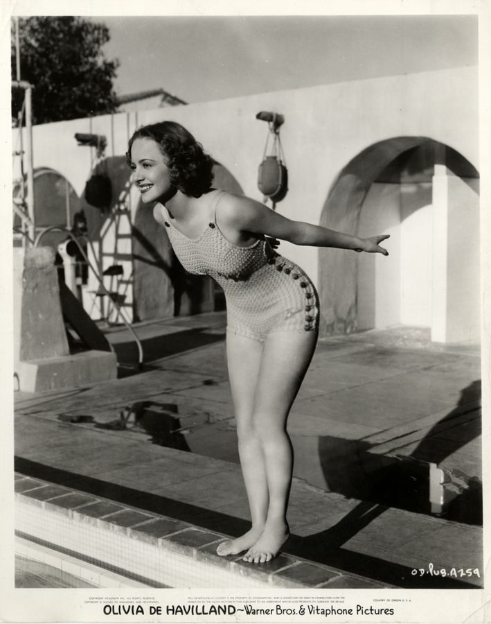 Olivia de Haviland in an untypical cheesecake bathing suit photo for Warner Bros. 1942