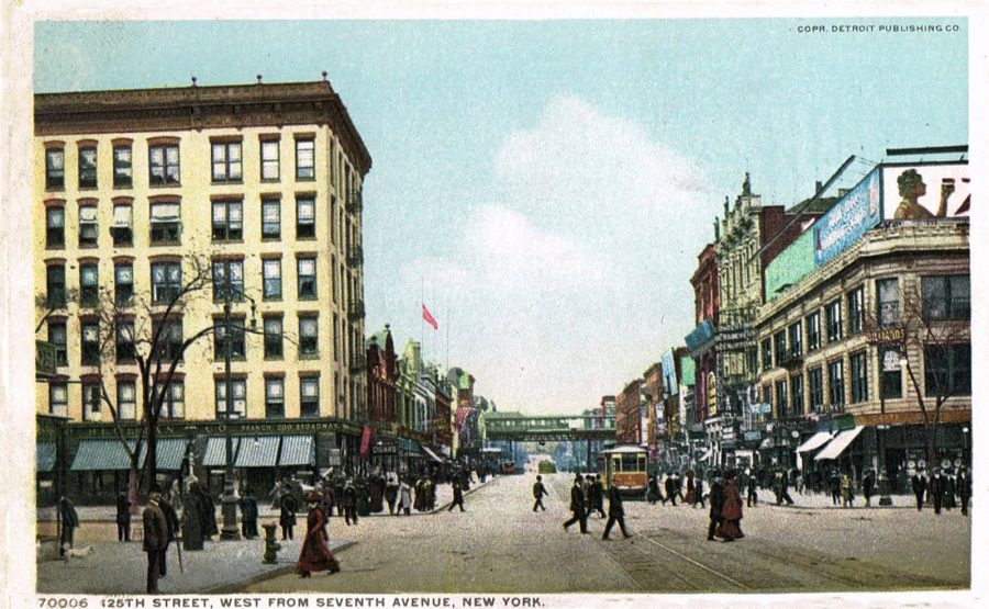 View of 125th Street looking west from 7th Avenue. The Hotel Winthrop is on the left the Harlem Opera House with finials atop its roof is on the right circa 1907.