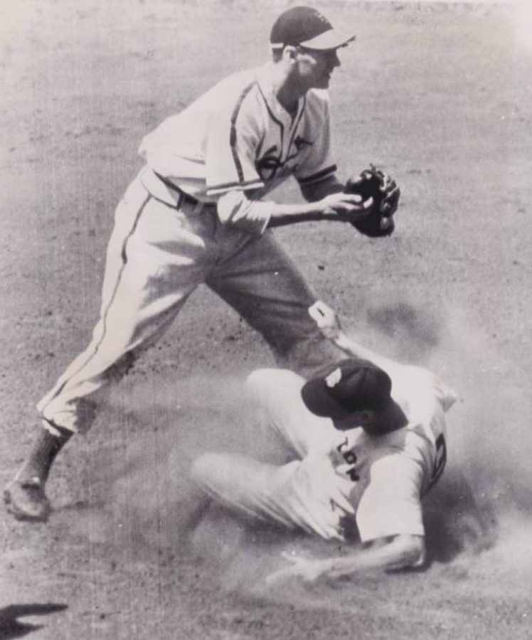 Ted Williams slides into second base with a double. Marty Marion is taking the throw.