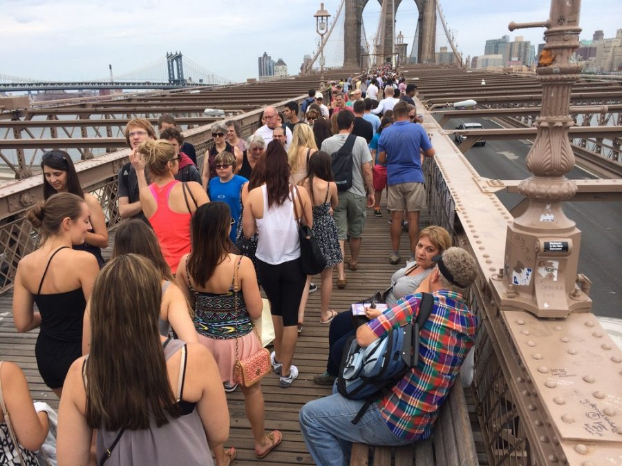 The Brooklyn Bridge pedestrian walkway is always crowded. photo via christiangood.net