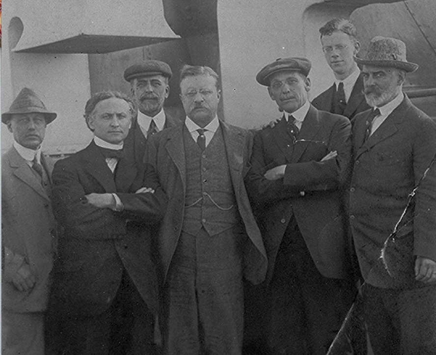 From left to right: William Hamlin Childs, Harry Houdini, J.C. Platt, Theodore Roosevelt, unidentified, Philip Roosevelt, L. F. Abbott