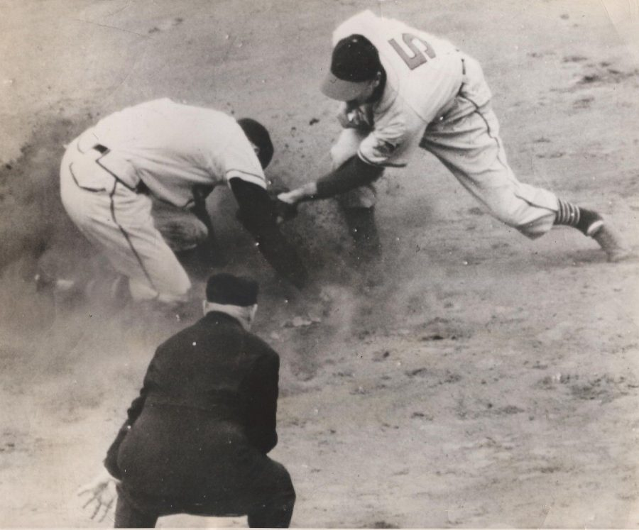 Cleveland's Lou Boudreau takes throw as Earl Torgeson steals second base in game 1 of the 1948 World Series. photo: Tony Bernato, International News Photos