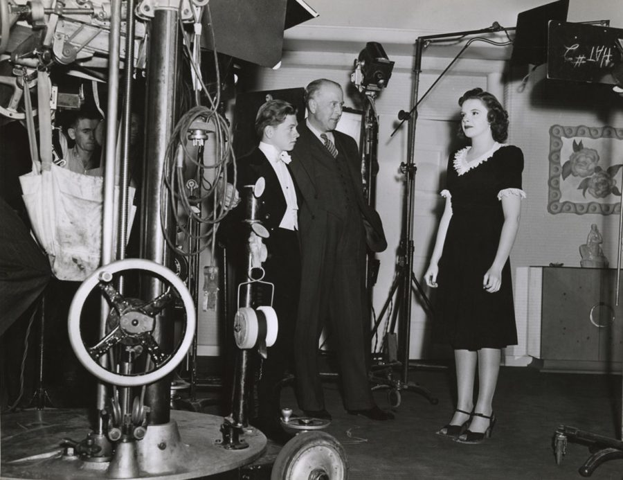 Mickey Rooney director George Seitz Judy Garland on the set of Andy Hardy Meets Debutante May 18, 1940