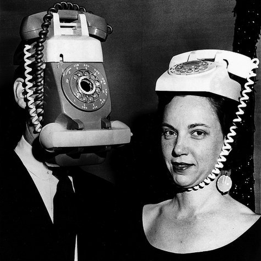 people 1960s with phones attached to heads
