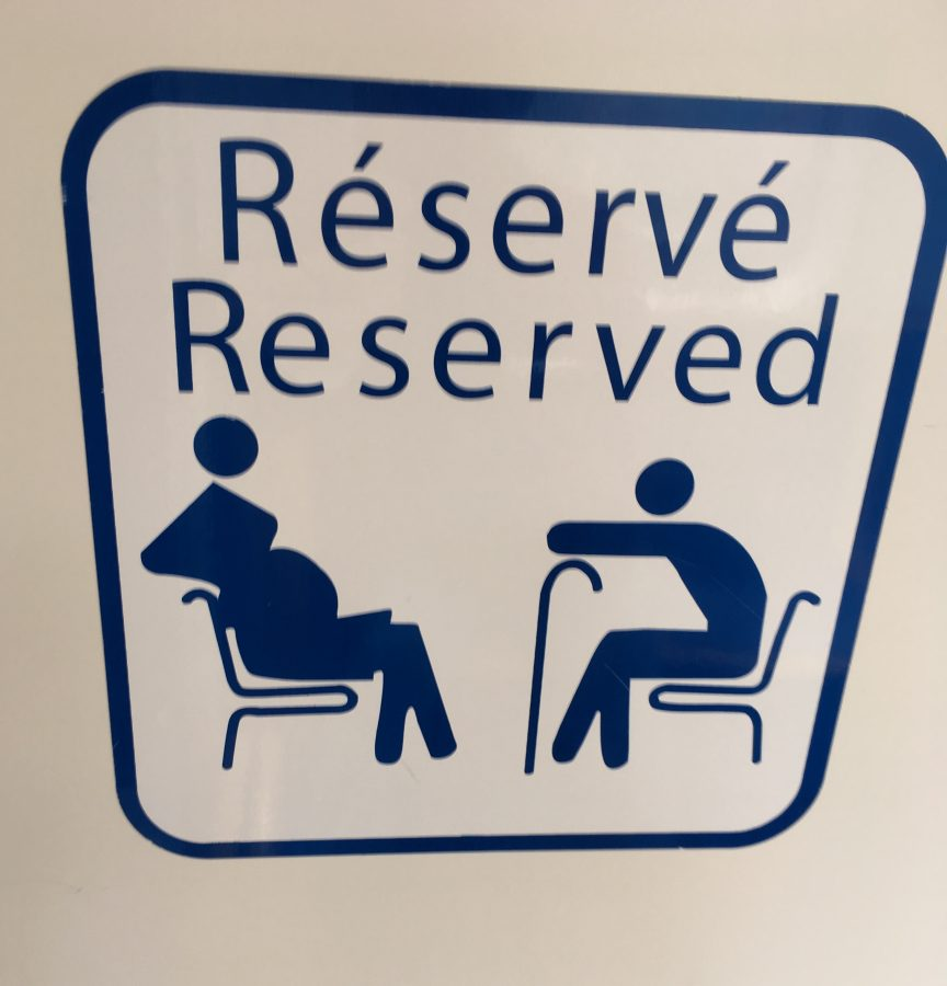reserved seating for pregnant women and elderly french metro sign